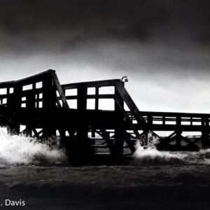 water rushes in to a pier
